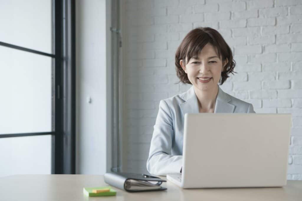 Woman attending virtual learning seminar