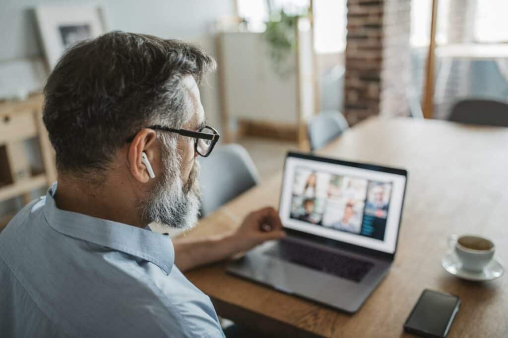 Man attending virtual learning seminar
